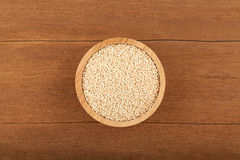 Quinoa in wooden bowl. On wood background Royalty Free Stock Photos
