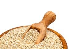 Quinoa in a wooden scoop Stock Photo