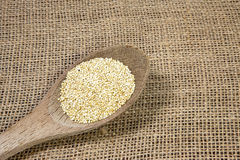 Quinoa and wooden spoon-concept royalty free stock photo