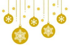 Quinquilharia e floco de neve do ouro no fundo branco com estrelas Foto de Stock