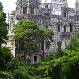Quinta da Regaleira palace in Sintra, Portugal. gothic building in trees Royalty Free Stock Image
