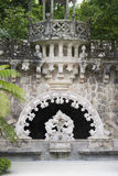 Quinta da Regaleira palace in Sintra, Portugal. Part of the park with tunnel. Impressive immortal Quinta da Regaleira in Sintra, Portugal Stock Photos