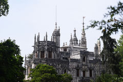 Quinta da Regaleira palace in Sintra, Portugal. view from park. Impressive immortal Quinta da Regaleira in Sintra, Portugal Royalty Free Stock Photo