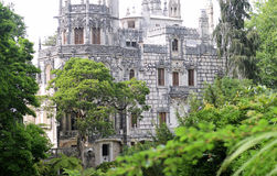 Quinta da Regaleira palace in Sintra, Portugal. view from park to gothc building. Impressive immortal Quinta da Regaleira in Sintra, Portugal Royalty Free Stock Photography