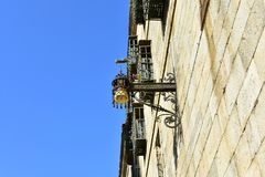 Old street light in Quintana Square close to Cathedral. Stone walls and iron details. Santiago de Compostela, Spain. Blue sky, sun stock photos