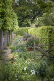 Quintessential vibrant English country garden scene landscape wi stock photos