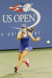 Quinze années de joueur de tennis Catherine Bellis pendant le deuxième match de rond à l'US Open 2014 Photographie stock libre de droits