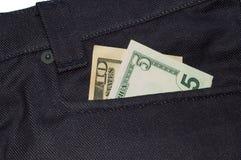 Quinze dólares em um poc das calças de brim imagem de stock