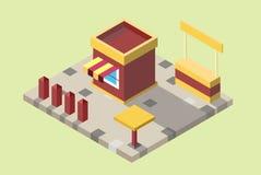 quiosco Amarillo-rojo con un escaparate con una tabla y una cerca Fotografía de archivo libre de regalías