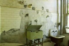 Équipe chirurgicale sur le mur de l'hôpital d'Ellis Island Photographie stock libre de droits