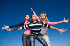 Équipe heureuse de jeunes de rire Photographie stock libre de droits