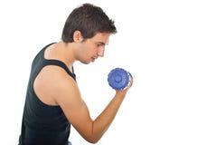 Équipez faire l'exercice avec la cloche sourde-muette Photographie stock libre de droits