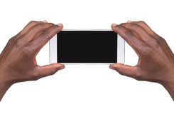Équipez prendre une photo utilisant un téléphone intelligent Photos libres de droits