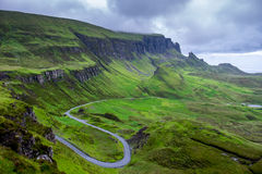 Quirang and devious road. In a cloudy day, Isle of Skye, Scotland Royalty Free Stock Photo