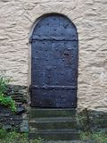 Quirky Castle Door Made of Iron Sheets and Bolts stock photo