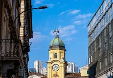 Quirky Clock Tower in Rijeka. With some old buildings and the sky in background. Main sqare in the city of Rijeka Royalty Free Stock Photography