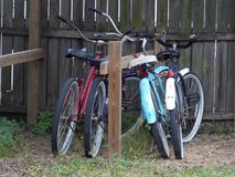 Quirky Collection of Cruisers. This collection of bicycles may be found in Uptown St Augustine and have been provided for one of the hundreds of Air B&Bs in the Stock Image