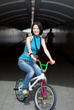 Quirky, funky chinese woman on street bike. Quirky portrait of well-dressed chinese woman on street bike Stock Photo