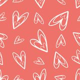 Quirky hand drawn soft cream doodle hearts on coral background as seamless vector pattern stock illustration