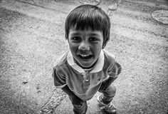 Quirky Little Gypsy Kid In The Street. A cute and quirky little gypsy kid in the street of small summer vacation town named Cinarcik - located in Marmara region Stock Photography