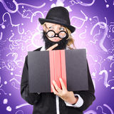 Question man reading puzzle solving book. Quirky purple portrait of a knowledgeable business person thinking with finger to fake beard while reading puzzle Royalty Free Stock Photos