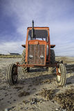 Quirky red beach tractor Stock Photography