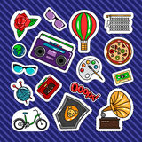 Quirky style retro patches. Set with cassette recorder, bicycle, air balloon and sunglasses. Vector stickers or badges collection on blue background Royalty Free Stock Images