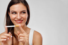 Quit Bad Habit. Beautiful Happy Woman Holding Cigarette. Quit Bad Habit. Closeup Of Beautiful Happy Healthy Woman Holding Cigarette In Hands. Portrait Of Young stock photos