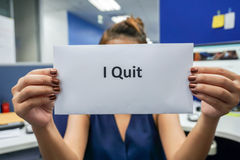 Quit the job. Close up woman hold a piece of paper of I quit the job Royalty Free Stock Photography