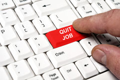 Quit job key. Pressed by male hand stock image
