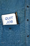 Quit job message. On notepad royalty free stock photo