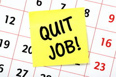 Quit Job!. A reminder to Quit Job on a yellow sticky note attached to the page of a calendar Stock Images