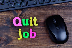 Quit job words on table. Quit job words on wooden table royalty free stock image
