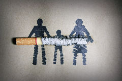 Quit. Smoke cigarettes hurt people in the family stock photography