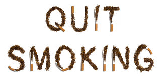 QUIT SMOKING. Written with destroyed cigarettes Royalty Free Stock Image