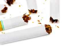 Quit Smoking. Concept with broken, unsmoked cigarettes Stock Photography