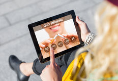 Quit Smoking app on tablet Royalty Free Stock Photos