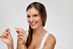 Free Quit Smoking. Beautiful Happy Woman Holding Broken Cigarette Stock Photography - 84646832