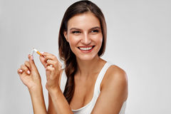 Quit Smoking. Beautiful Happy Woman Holding Broken Cigarette stock photos