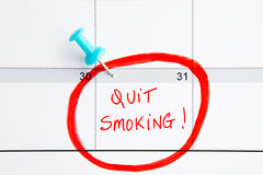 Quit Smoking Calendar. With handwriting in red with blue push pin Stock Photography