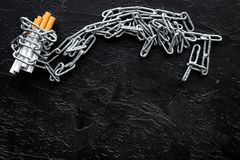 Quit smoking. Cigarettes in chains on black background top view space for text royalty free stock photos