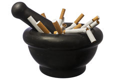 Quit smoking - Cigarettes in pestle over white royalty free stock image