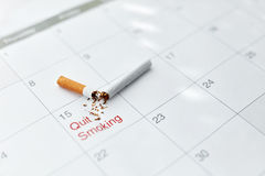 Quit Smoking. Close Up Of Broken Cigarette Lying On Calendar Stock Images