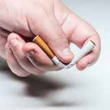 Quit smoking conceptual image male hand bending a cigarette Royalty Free Stock Photography