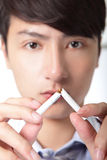 Quit smoking. Doctor hands breaking the cigarette, close up, focus on hand, asian model Royalty Free Stock Photo