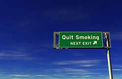 Quit Smoking - Freeway Exit Sign Royalty Free Stock Photo