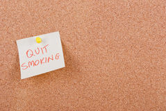 Quit smoking. Note pinned to cork board Royalty Free Stock Photo