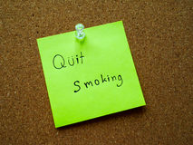 Quit smoking on post it note. For remind on wooden board Royalty Free Stock Image