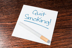 Quit Smoking Reminder With Cigarette On Wooden Shelf Stock Images