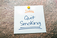 Quit Smoking Reminder For Today On Paper Pinned On Cork Board. A Quit Smoking Reminder For Today On Paper Pinned On Cork Board royalty free stock image